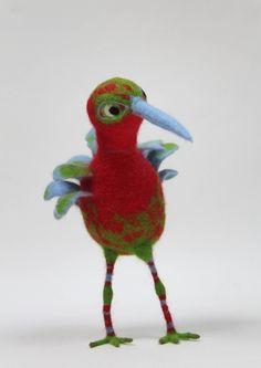 Red cross bird sculpture