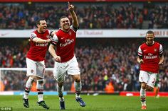 Grinning: Lukas Podolski enjoys himself after wrapping up the win in the 90th minute