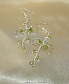 Wire wrapped vines and leaves with green glass beads Wire Work, Wire Wrapped Jewelry, Wire Wrapping, Vines, Glass Beads, Leaves, Green, Wire Wrap Jewelry, Arbors