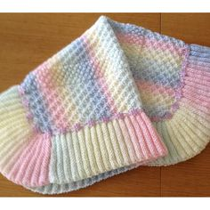 Crochet Baby Blankets Rainbow Dust Baby Blanket - Pretty baby blanket using three different but easy knitting stitches. The added trimming is optional and uses in the region of three metres See more See less Easy Knitting Patterns, Crochet Blanket Patterns, Free Knitting, Baby Knitting, Knitting Stitches, Knitting Needles, Knitting Projects, Easy Patterns, Easy Knit Baby Blanket