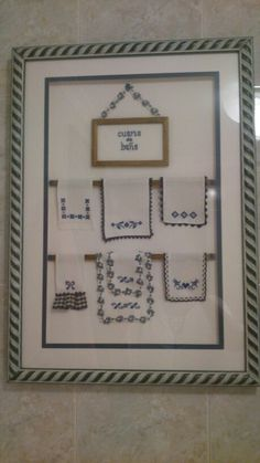 Framed mini embroidered towels!  How cute is that?!