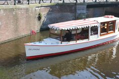Historic Boat Tour Amsterdam @ canal boat Delphine Amsterdam Balade en bateau historique Amsterdam