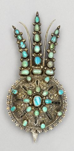 Late-Ottoman turban pin.  From the Balkans, 19th century.  Silver set with turquoise.
