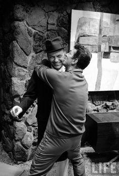 Dean Martin kissing a laughing Frank Sinatra, 1965.