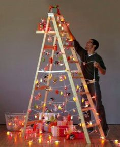 Re-purpose. A wooden ladder becomes a great ornament display with the addition of string lights.