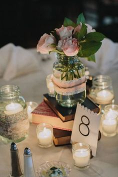 centerpieces with old books and candles - Google Search