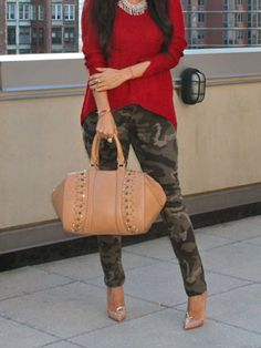 Camouflage pants are usually edgy, but can be sweet with a pink blouse