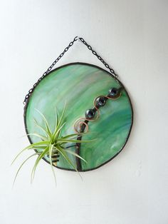 I love this...It's so light and refreshing!  Stained glass Panel Air Plant Holder Redondo Verde by glassetc