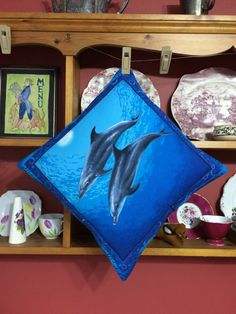 SALE Dolphin quilted pillow. Bright coloured dolphins theme cushion. Mother's Day, birthday, housewarming gift. Unique quilted soft furnishi by CraftHillArtisans on Etsy https://www.etsy.com/uk/listing/277635266/sale-dolphin-quilted-pillow-bright