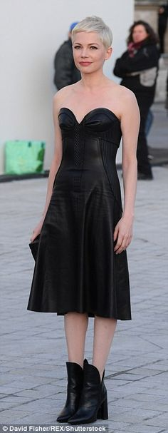 The 36-year-old Manchester By The Sea actress looked incredible at the show in her racy gown which she made high fashion with her pixie crop and ankle boots