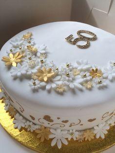 Golden Wedding Anniversary Cake. 50 years of marriage celebration fruit cake.
