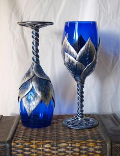 Cobalt Glasses with Winter leaves 1 by MaevinWren, via Flickr    I WANT! They would go with my dishes, and salt shakers and my candle holders!
