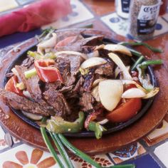 Fajitas  Though Tex-Mex-style fajitas are unknown in Mexico, grilled skirt steak is eaten with tortillas in Nuevo León, under the name arrachera al carbon.    From: saveur.com
