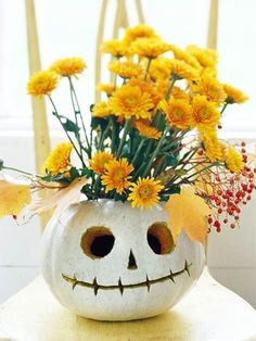 This would be so cute done with one of those foam pumpkins and silk flowers. That way you can keep it to use year after year!