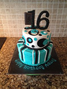 Two tiered aqua/black sweet sixteen cake. Decorated with a friend for her birthday.