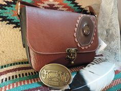 Hand crafted Meduim Purse with Natural rusty brown Leather with inlayed stone by…