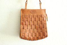 light tan woven leather shoulder bag. $20.00, via Etsy.