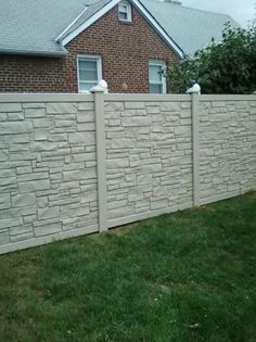 beige vinyl stone fence installed in Queens Village, NY, by Liberty Fence & Railing.