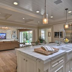 Light and unfinished feel of wood floors. Kitchen 9 foot ceilings. Marble, white ceilings.