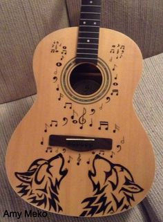 Wolf design on guitar