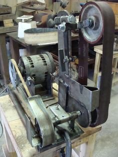Belt Grinder by FieryFurnace -- Homemade belt grinder constructed from surplus steel, a 3/4 hp motor, bushings, pulleys, springs, contact wheels, and a toggle switch. http://www.homemadetools.net/homemade-belt-grinder-44