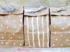 place the cookies in a plastic bag and put it inside the brown paper bag. Fold the top of the bag over 3 inches and punch holes through the bag around the lip. Thread ribbons, tinsel or fabric strips through the holes to create an artful and beautiful package.