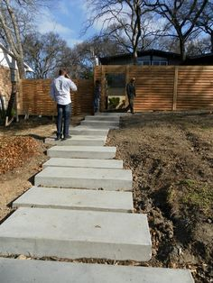 These under construction concrete steps are a great look for this modern/ contemporary home in Dallas, TX.  www.onespecialty.com