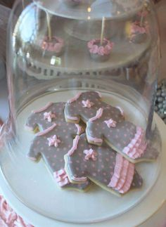 Cute onesie cookie at a tutu cute baby shower party! See more party planning ideas at CatchMyParty.com!