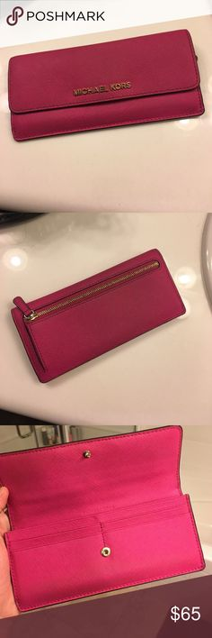 Michael Kors raspberry slim wallet Style code 32F3GTVE7L. Retail value $228. Color- raspberry. 8 card slots. Zipper for change on back. Great condition Michael Kors Bags Wallets