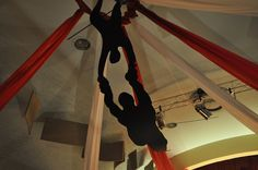Circus Party: Create flying trapeze artists with silhouettes suspended from the ceiling.