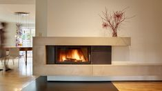 Henrichs Ofenbau from Trier. Modern fireplace and tiled stove from Ofenbauer. - Henrichs Ofenbau from Trier. Modern fireplace and tiled stove from Ofenbauer. High quality and indi - Modern Fireplace Decor, Wood Fireplace Surrounds, Contemporary Fireplace Designs, Modern Electric Fireplace, Fireplace Tile Surround, Fireplace Tv Wall, Linear Fireplace, Living Room With Fireplace, Modern Fireplaces