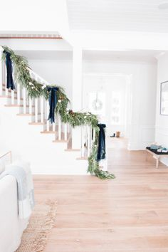 i put some garland on our staircase this weekend and i'm kind of obsessed with it! so i thought i'd round up more staircase garland to oggle. Christmas Stairs, Blue Christmas Decor, Indoor Christmas Decorations, Natural Christmas, Merry Little Christmas, Simple Christmas, Beautiful Christmas, Winter Christmas, Holiday Decor