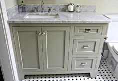 offset sink makes for better use of countertop by resident. Urban Grace Interiors