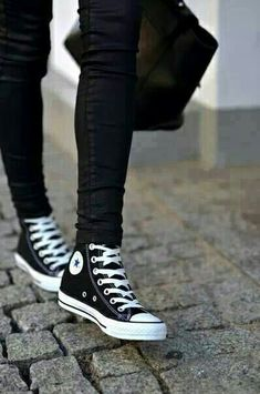 Black high-top Chucks.