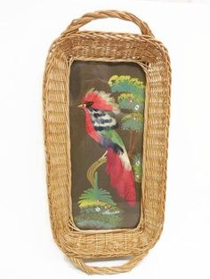 Very collectible Mexico souvenir tray features a glassed-over mixed-media feather picture of a beautiful exotic bird with a wicker tray frame. The image measures 6 x 10, the tray itself about 19 x 9 1/4. I see one area of slight discoloration in the upper left hand corner (see last photo) but other than this, the tray is in very good condition.  EXCESS SHIPPING/PACKAGING COSTS PROMPTLY REFUNDED IF OVER $1.00.