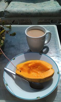 Perfect Maui breakfast: a locally grown papaya and kona coffee while sitting in the sun on Haleakala. (Maui, Hawaii)