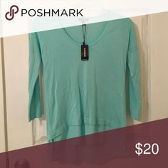 New With Tags NWT Express Sea Green 3/4 Sleeve This beeeeautiful top is too small on me - otherwise, I'd keep it! The color is stunning and soft. Makes a great gift, too. Comes with a bottom 'layer'. No rips, stains or tears. No trades, but will consider reasonable offers. Smoke-free home. (Sorry for the creases, I had this folded in my closet). Express Tops Blouses