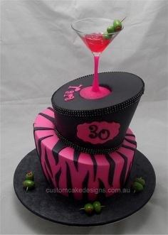 This 2 tier topsy turvy cake was made for a 30th Cocktail themed birthday party.
