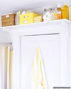 Clever shelf over the bathroom door for extra storage! (make sure you have a small ladder handy)