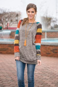 This baseball inspired top goes above and beyond! Those multicolored color block sleeves are so much fun! And the soft taupe looks so warm and inviting! Material has a generous amount of stretch. Miranda is wearing the small. Sizes fit: Small- 0-4; Medium- 6-8; Large- 10; Extra Large- 12