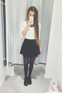 Black and white outfit with the white quarter sleeve top, black circle skirt, black tights, and black lace up shoes