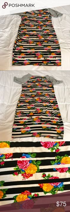 """LuLaRoe Julia """"The Julia"""" Flowers and Stripes Excellent, excellent used condition LuLaRoe Julia dress in one of the most sought after prints available. Material is stretchy. No pilling, stains, or fading that I can see - but I could have overlooked something. Worn a few times and washed per company guidelines. I have (another) baby on the way so I need to sell some of my valued lovelies and use the money for other things. I reserve the right to chicken on selling this because I love it…"""