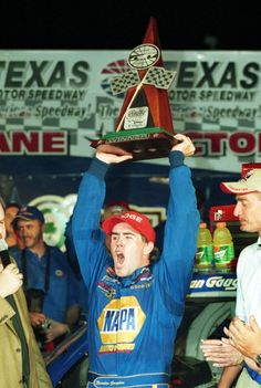 June 7, 2002: Brendan Gaughan, driver of the #62 NAPA Auto Parts Dodge, holds up the NASCAR Craftsman Truck Series O'Reilly 400 winner's trophy in Victory Lane.
