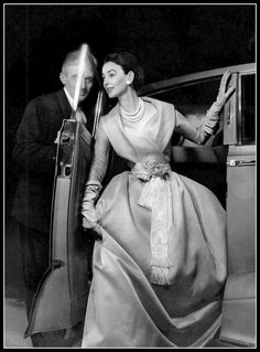 """Dorian Leigh in pale blue organdy """"Marie-Antoinette"""" evening gown with fichu collar and white moiré sash, by Christian Dior, pearls are by Francis de Winter, photo by Guy Arsac, 1955"""