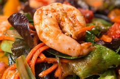 Shrimp and roasted veggie salad. I'd like to try it over rice instead of greens for dinner sometime!
