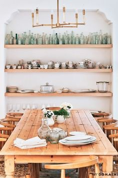 Bright and light spaces. built in shelving with displayed collection. rustic dining room with rustic wooden table and chairs.