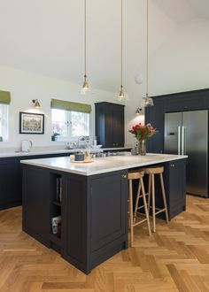 This substantial kitchen island houses plenty of storage, book shelves and bar stools.
