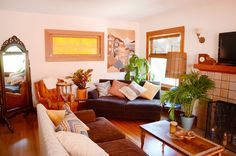 """A stained-glass window in the living room and sunlight boucing from the red building next door constantly fill Jen's home with """"golden hour"""" light."""
