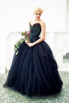 Oh my...  I think this it! The dress. The reason I started this board was to find the perfect ball gown I was picturing in my head. Corseted, tulle, black... This is it!!!!!