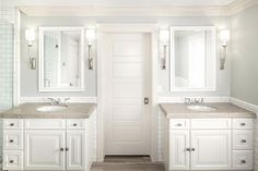 Limestone floors and counters + BM Owl Grey Paint + Circa Lighting Sconces | White + Gold